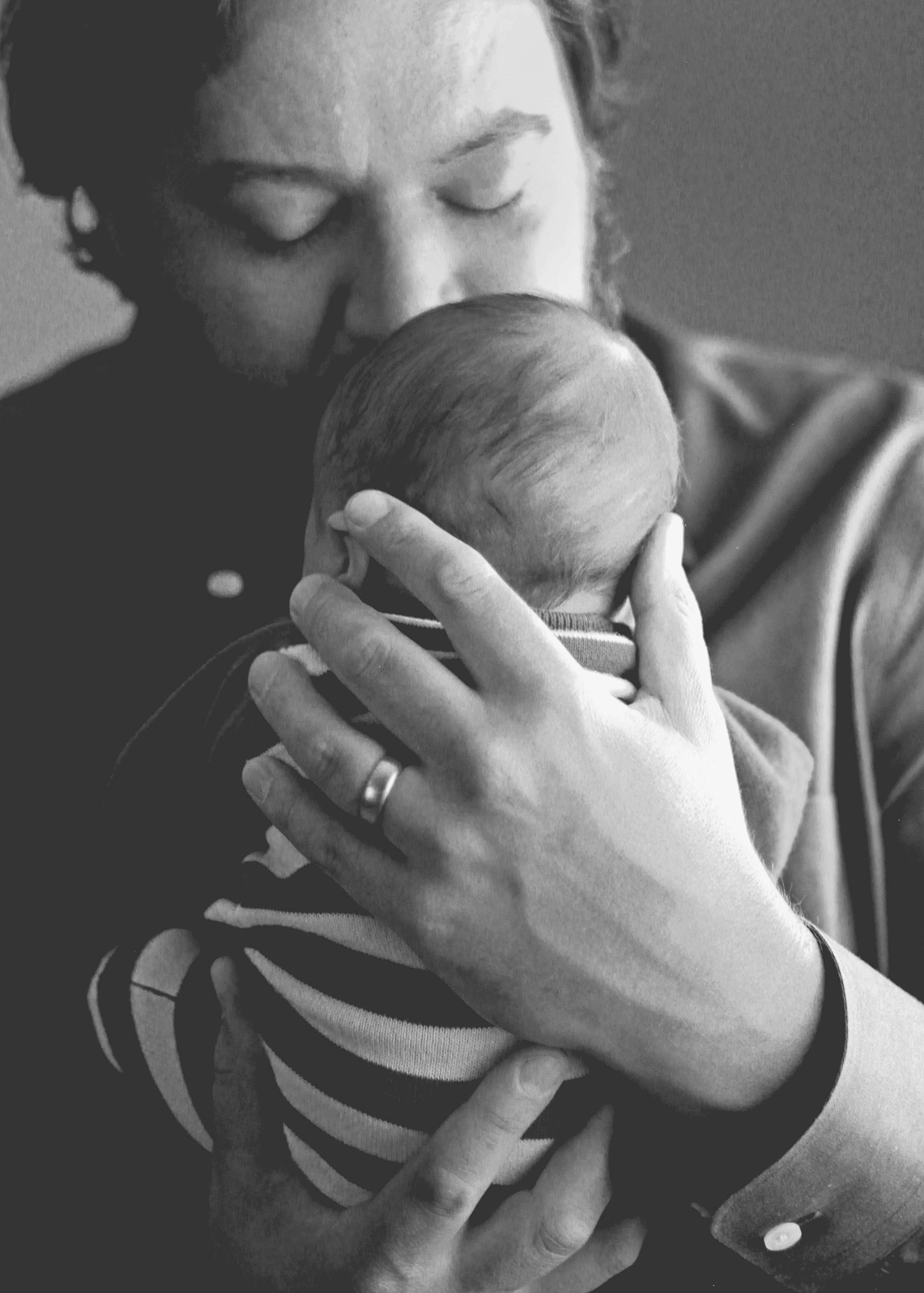 Father holds his newborn baby - Colorado Dream Company Postpartum Support